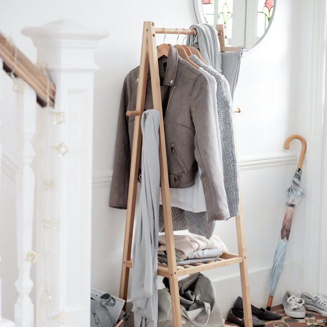 Collection Belvoir bamboo clothes rail in hallway with jackets, scarves and bag.