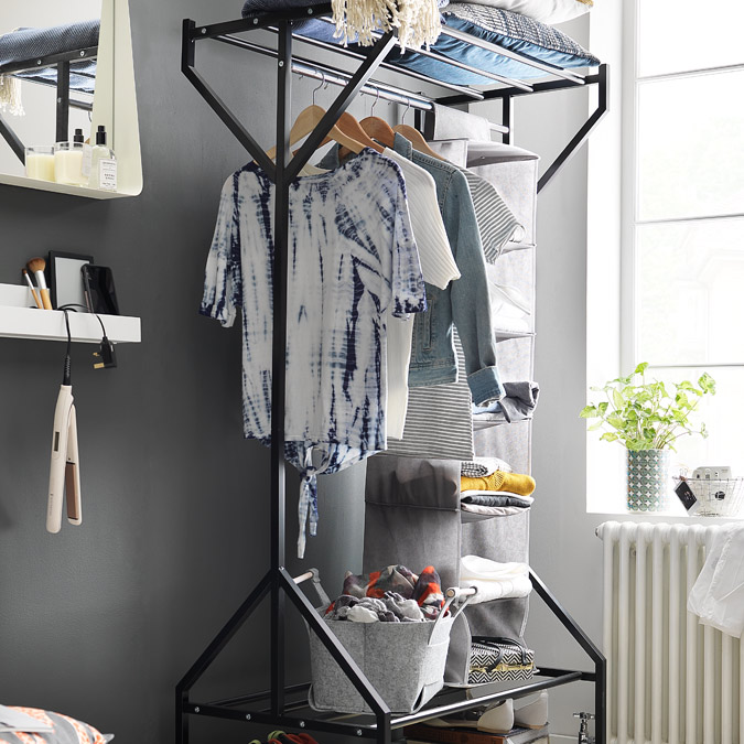Black clothes rail for hanging up guests clothes.