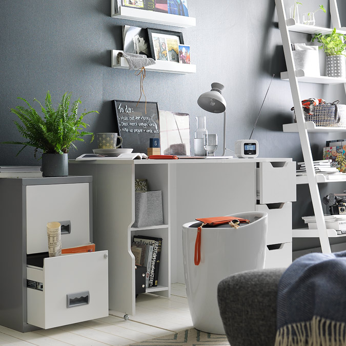 White office desk with storage stool and filing cabinets for paperwork.